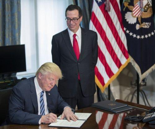 Trump targets more Obama-era regs that guard against corporate abuses
