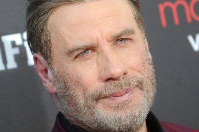 John Travolta shares photo of 8-year-old son