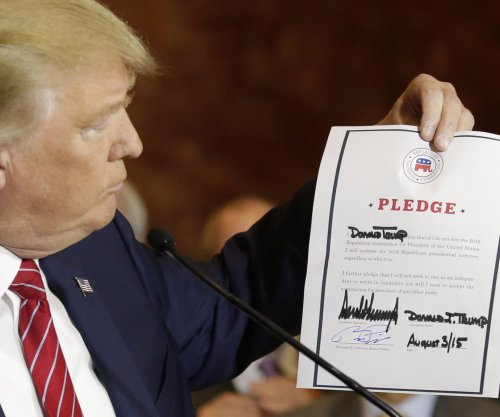 Trump signs loyalty pledge, says he won't go outside GOP for nomination