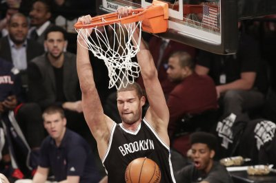 Trevor Booker, Brook Lopez lead Brooklyn Nets past Orlando Magic