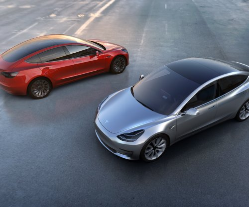 Tesla delivers first 30 Model 3 sedans at unveiling ceremony