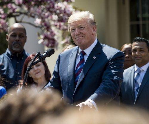 Trump touts tax cuts, boost to American jobs