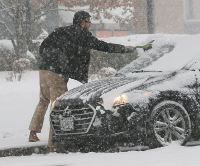 Slow-moving storm to keep dumping snow over Midwest