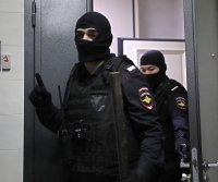 Russian police raid Navalny's homes, offices