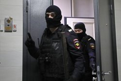 Russian police raid Navalny's home, offices