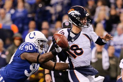 Andrew Luck, Colts end Broncos' unbeaten run