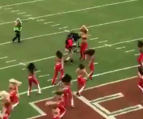 Kansas City Chiefs cheerleader gets ran over by cameraman