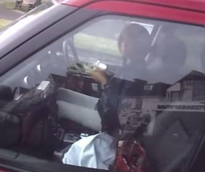 British motorist busted on camera eating cereal behind the wheel