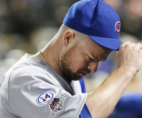 Chicago Cubs LHP Jon Lester pitches with floating bone chip