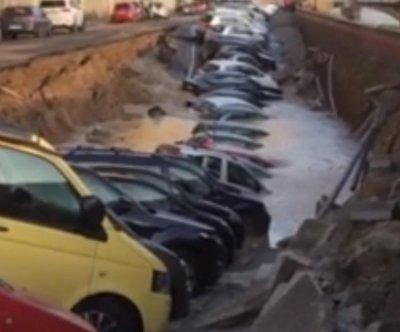 Giant sinkhole on Italian street swallows dozens of cars