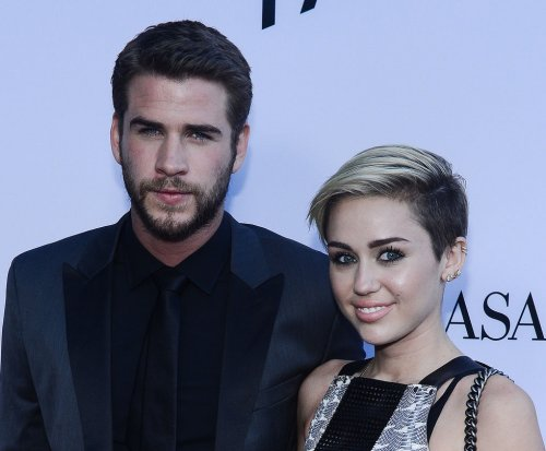 Miley Cyrus 'happy' with Liam Hemsworth, says dad Billy Ray