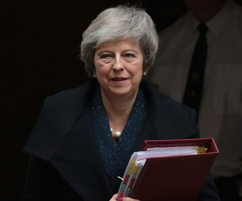 Theresa May survives no-confidence vote to remain as British PM