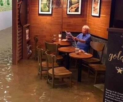 Hong Kong 'Starbucks uncle' becomes viral hero for sipping coffee in a flooded cafe