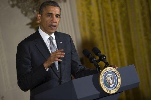 President Obama visits city in Arkansas hit by tornado