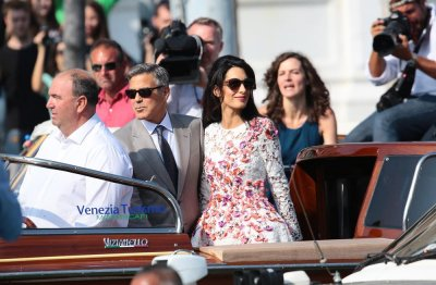 Amal Alamuddin changes last name to Clooney