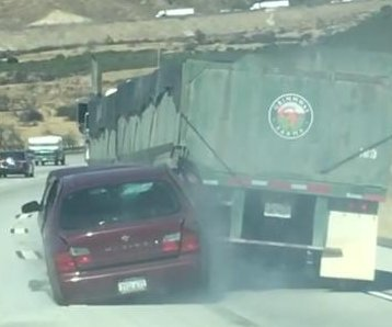 Car struck by lane-changing semi dragged on California highway