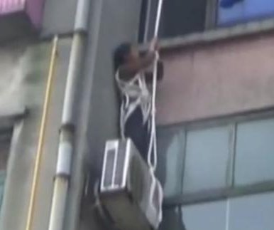 Woman, 63, rescued after trying to rappel to her apartment window