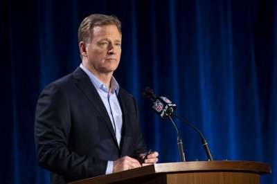 NFL players approve new collective bargaining agreement by slim margin