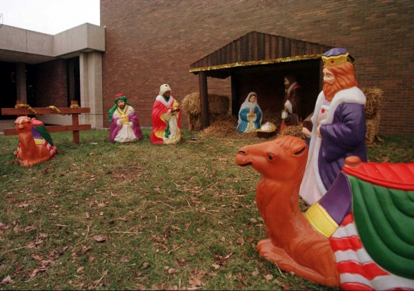 Living Nativity Scene Features Santa Bowing To Jesus