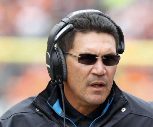 Carolina Panthers coach Rivera, family safe after house fire