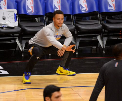 Steph Curry, Golden State Warriors edge Los Angeles Lakers in OT