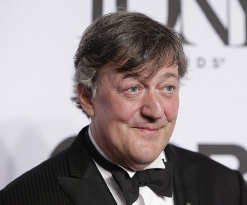 Stephen Fry and Elliott Spencer marry in England