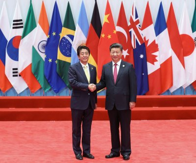 Report: Japan's Shinzo Abe under pressure for China summit