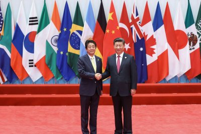 Report: Japan's Shinzo Abe under pressure for China summit