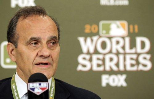 Torre leaves MLB to join Dodger bid