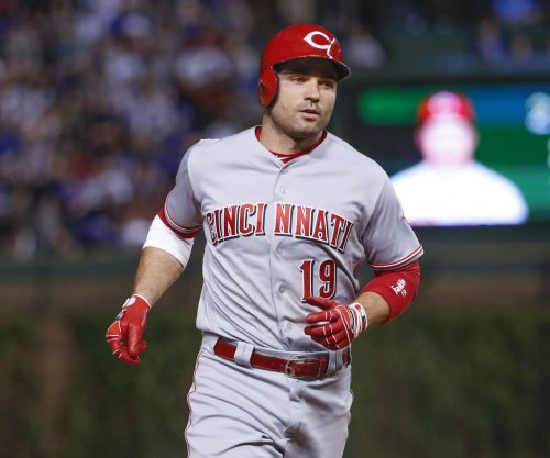 Reds score 7 runs in 9th inning to beat Indians