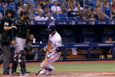 Tampa Bay Rays' Carlos Gomez falls in slow motion after being hit by pitch