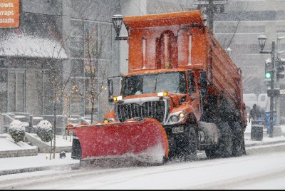 Crews struggle to keep roads clear as winter storm crosses the country