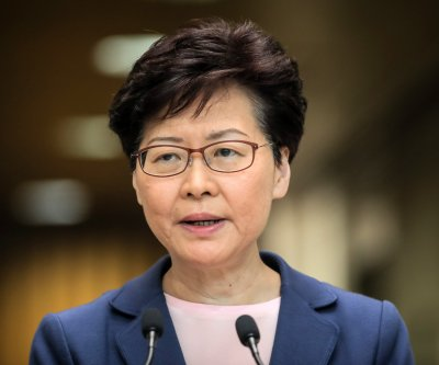 Hong Kong delays legislative elections for a year over COVID-19