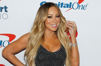 Mariah Carey says 'pushing through' with holiday special was important