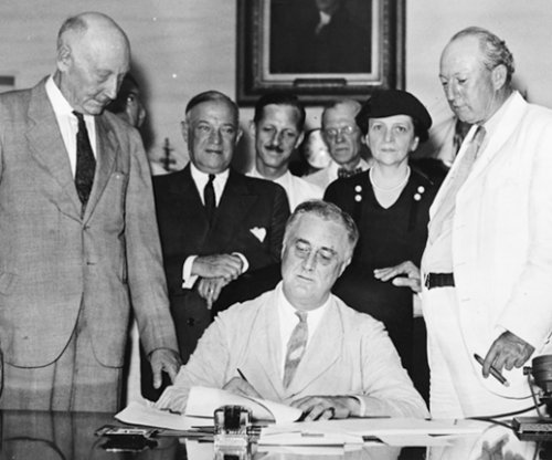 FDR signs Social Security bill into law