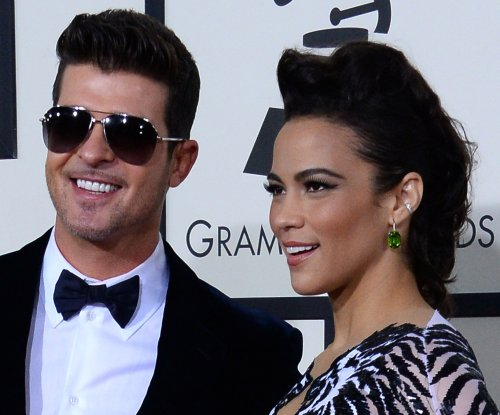 Robin Thicke spent Christmas Eve with Paula Patton
