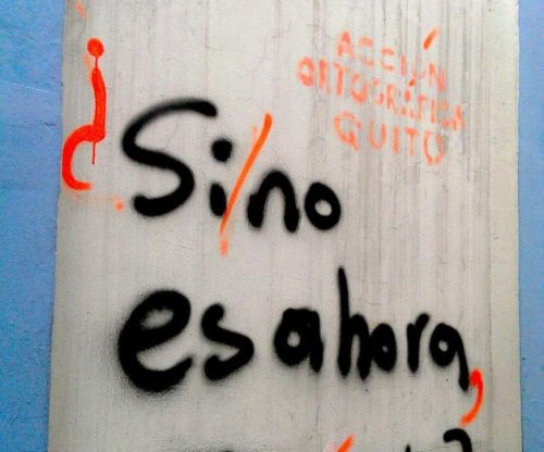 Vigilantes correct punctuation on Ecuador graffiti