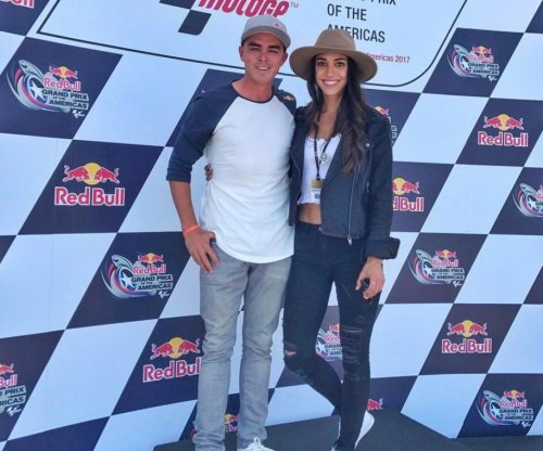 Rickie Fowler hangs out with Allison Stokke at Grand Prix race