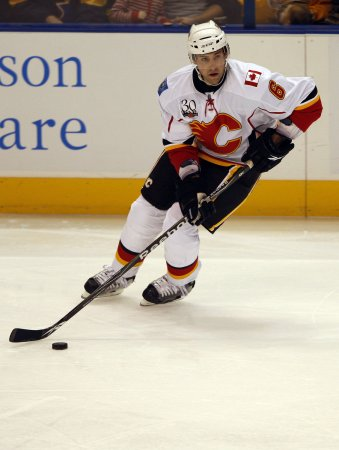 Flames sign Sarich for 2 more years