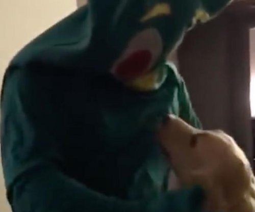 Man excites dog by dressing as favorite 'Gumby' toy