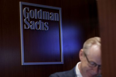 Goldman Sachs cuts employee compensation amid down quarter