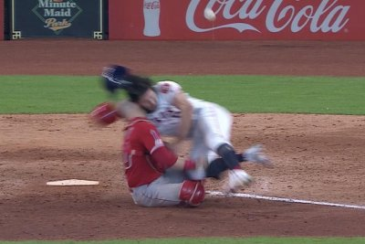 Angels catcher Jonathan Lucroy carted off after home plate collision