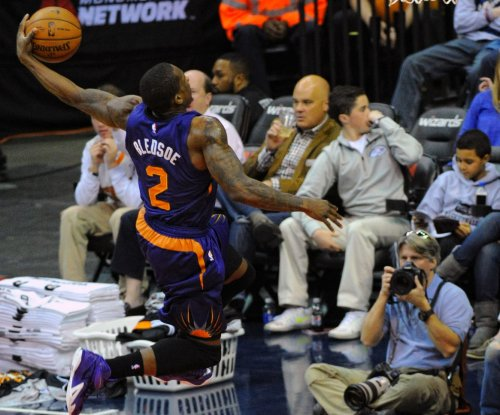 Bledsoe's career-high 33 points helps Phoenix Suns edge Portland Trail Blazers
