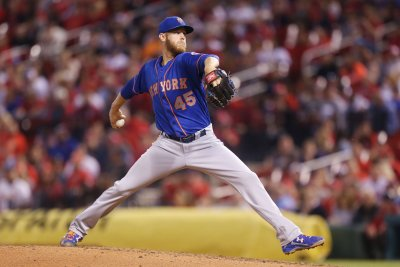 Mets face Cubs, aim to stay above .500