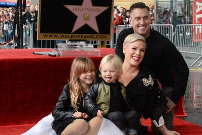 Pink says she's 'completely open' to adopting kids