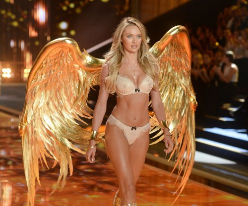 Candice Swanepoel skins knees in runway tumble at New York Fashion Week