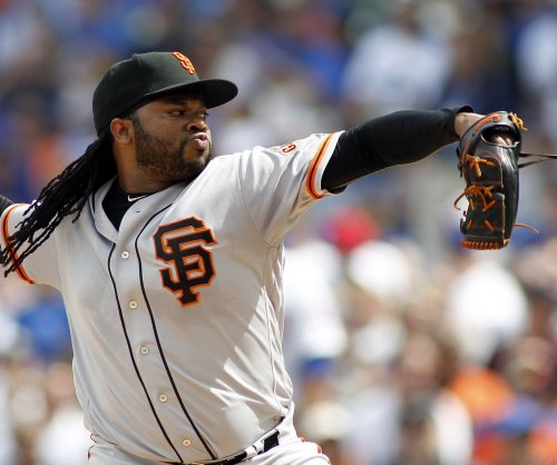 Johnny Cueto pitches San Francisco Giants past St. Louis Cardinals