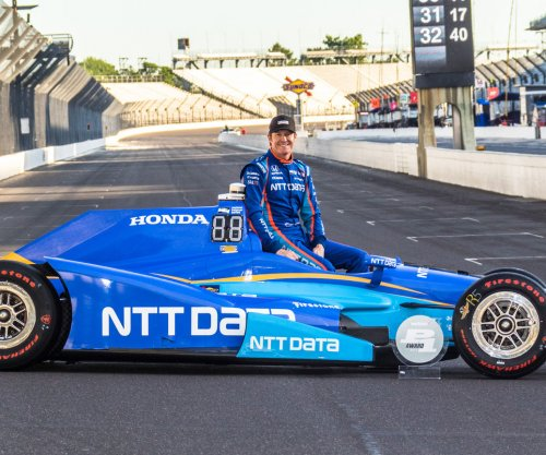 Gun for the border: Scott Dixon, Dario Franchitti robbed at gunpoint on late night food run