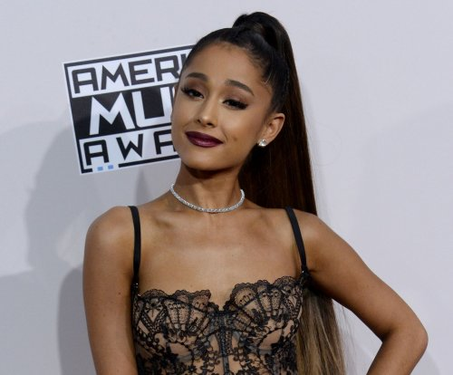 Ariana Grande 'thinking of our angels' as world tour resumes in Paris