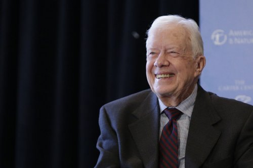 Jimmy Carter 'up and walking' after brain procedure, pastor says